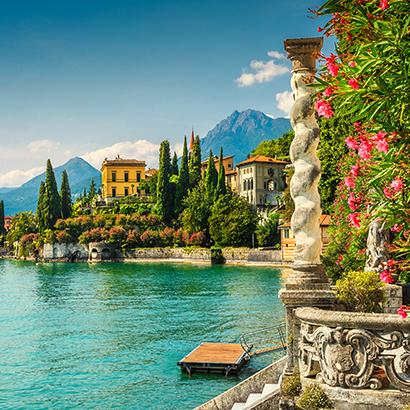 blue waters in the forefront of beautiful homes in Lake Como, Italy
