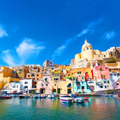 brightly colored homes adorn the coastline of Naples, Italy
