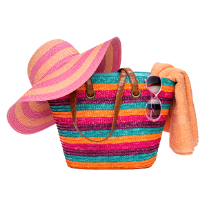 colorful beach bag filled with a wide brimmed hat, sunglasses and towel