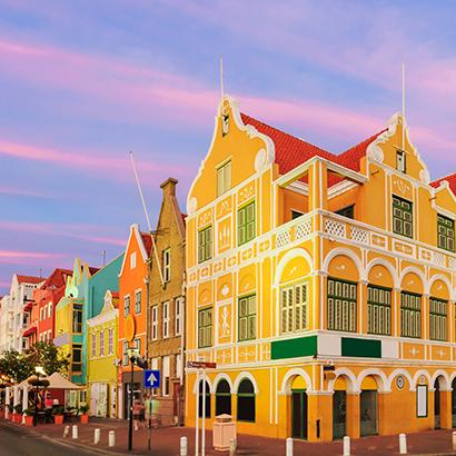 colorful buildings line the streets of Curacao