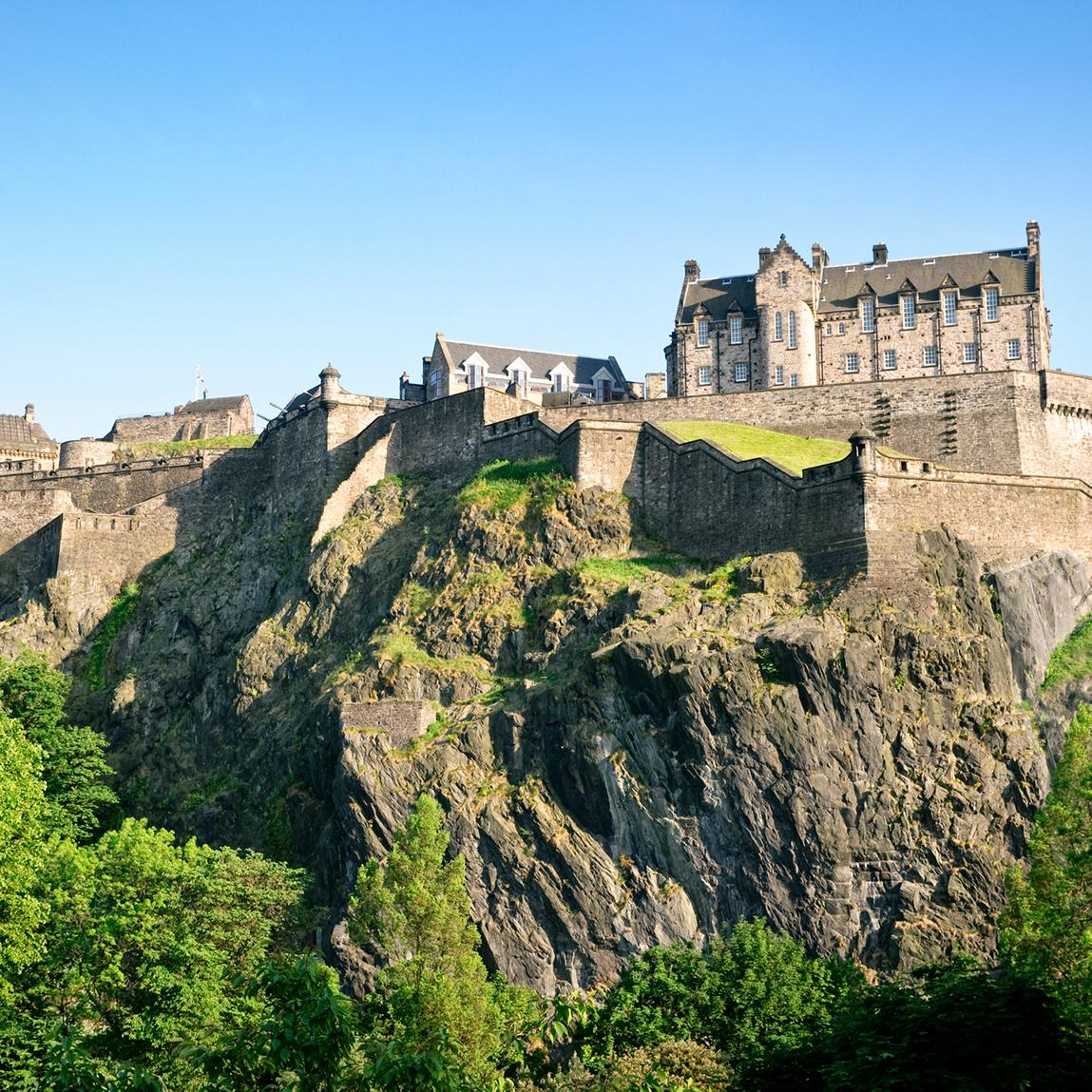 Views of cliffside castles and palaces in Edinburgh Scotland