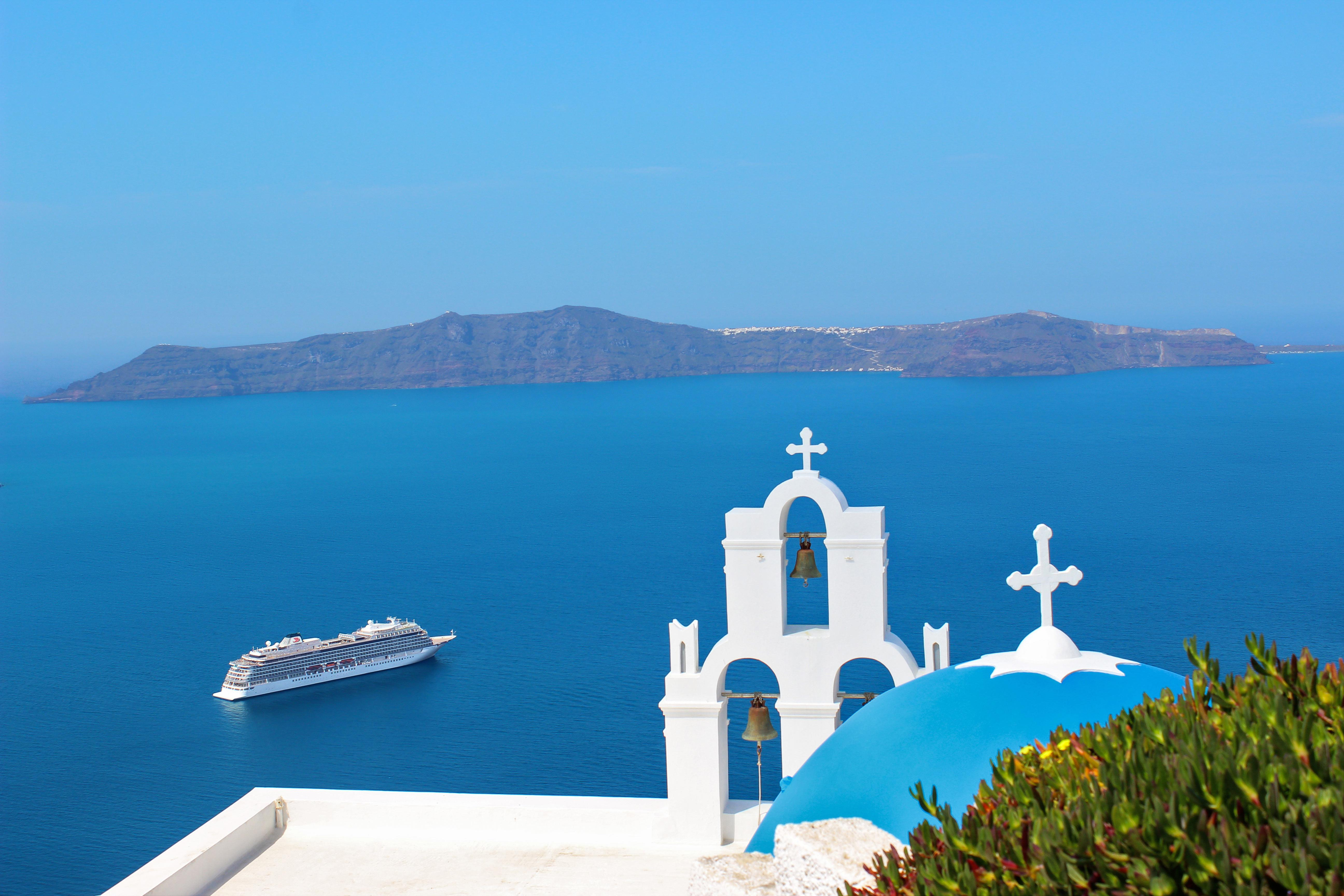 Journey to famed cities and ports like Santorini, Greece with Europe cruises