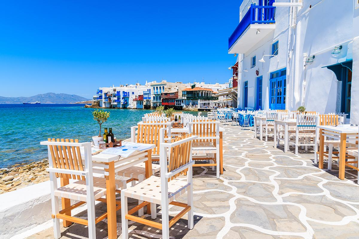 Dine by crystal blue coastlines with Greece tours and excursions