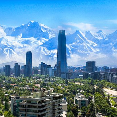 skyline in Santiago, Chile, Gran Torre overlooking the Andes mountains
