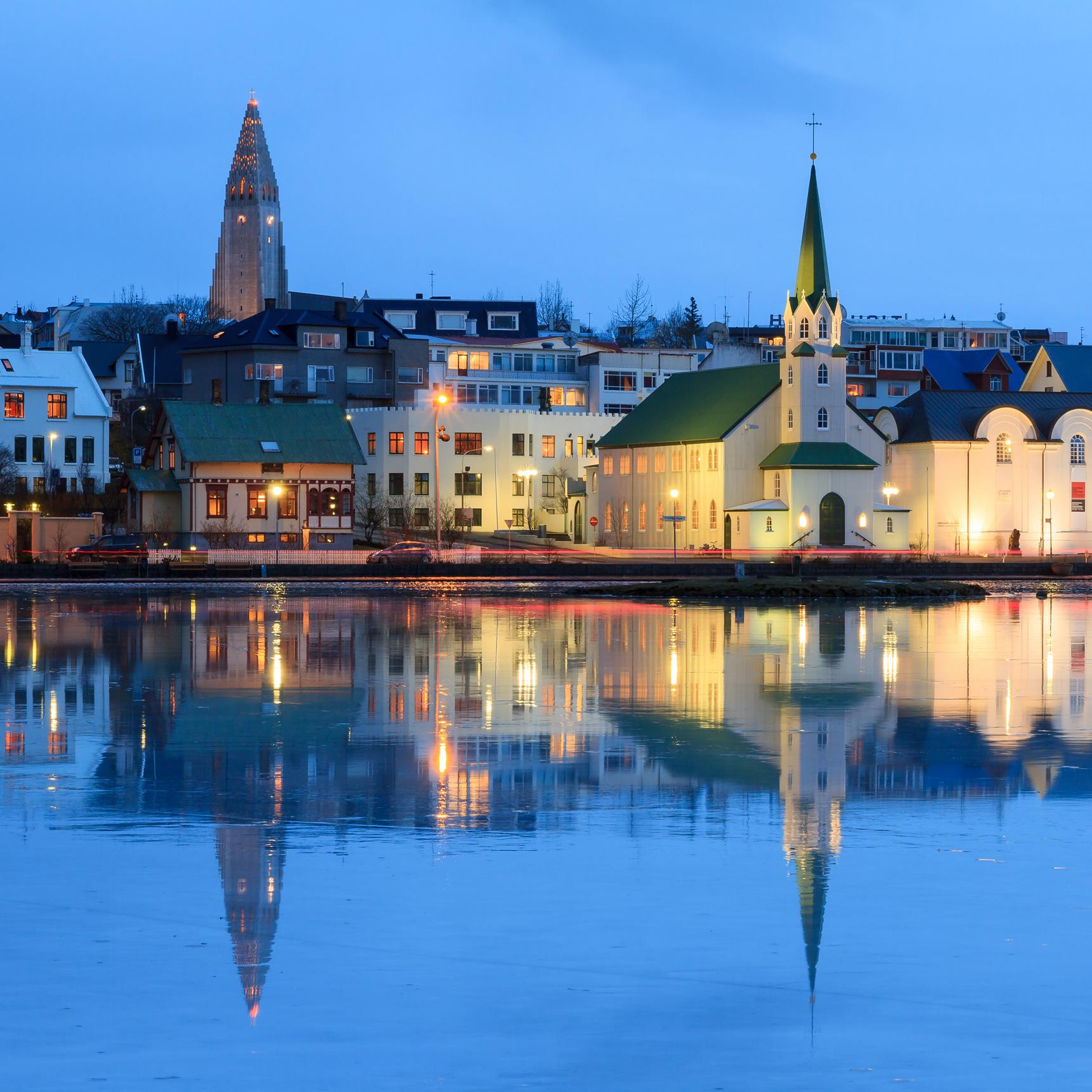 View Reykjavik at night with Iceland vacation packages