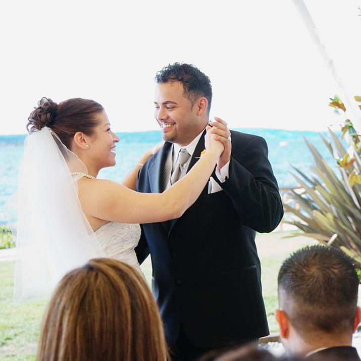A bride and groom share the first dance