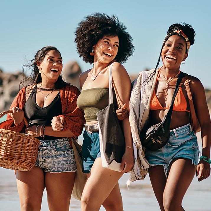 Girls laughing on a beach getaway