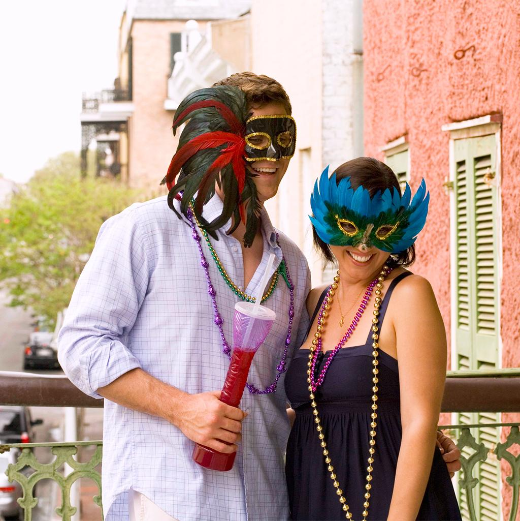 Couple wearing Masquerade masks during Mardi Gras in New Orleans