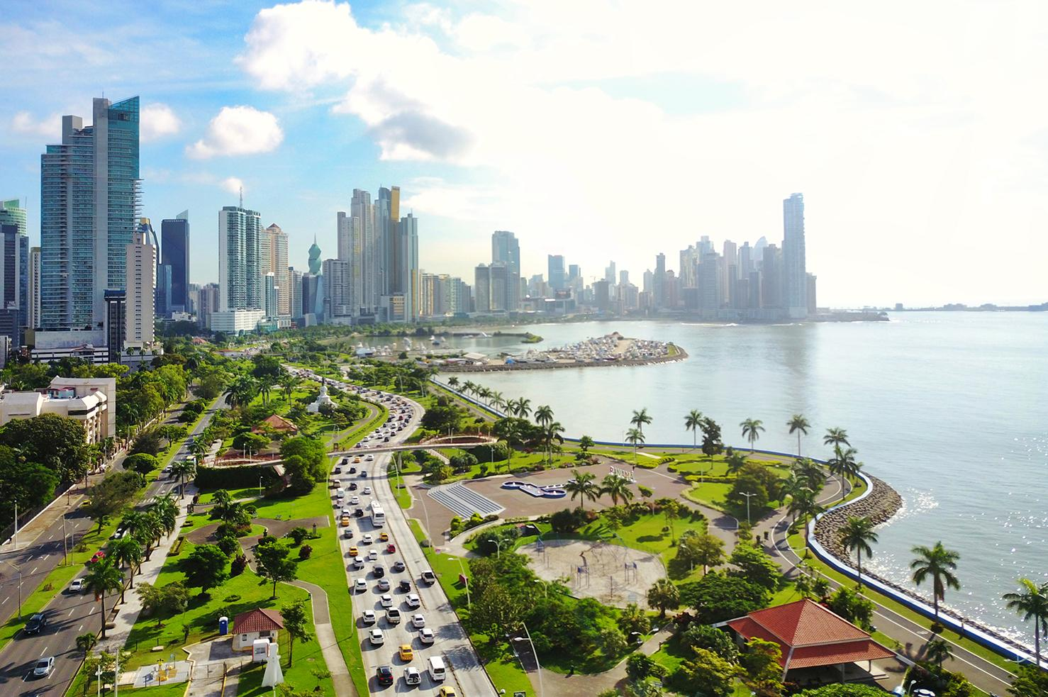 Sunlit views of Panama City's skyline overlooking the water