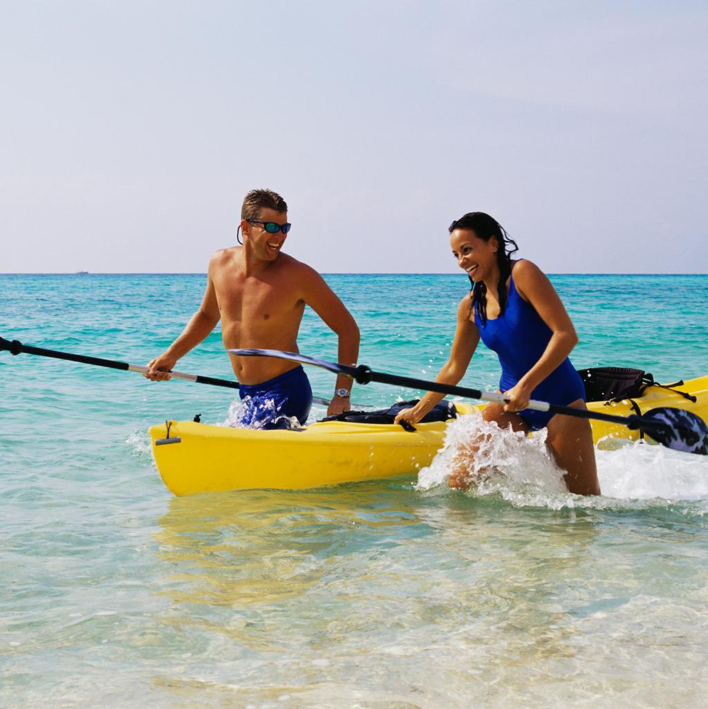 A couple kayaking on vacation in Providenciales