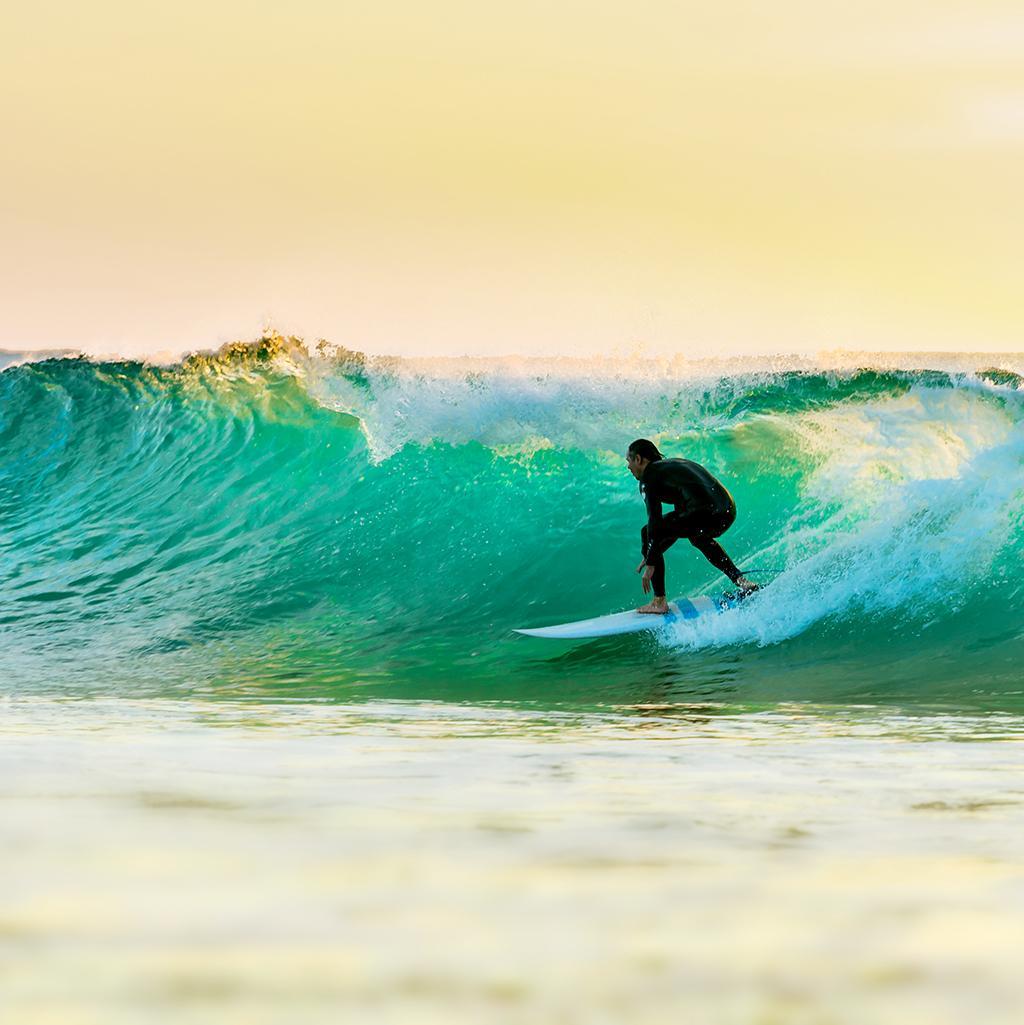 Man surfing on the beach in Queensland