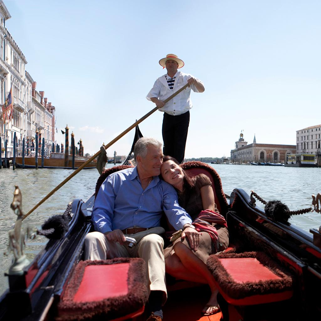 traditional gondola ride through the canals of Venice