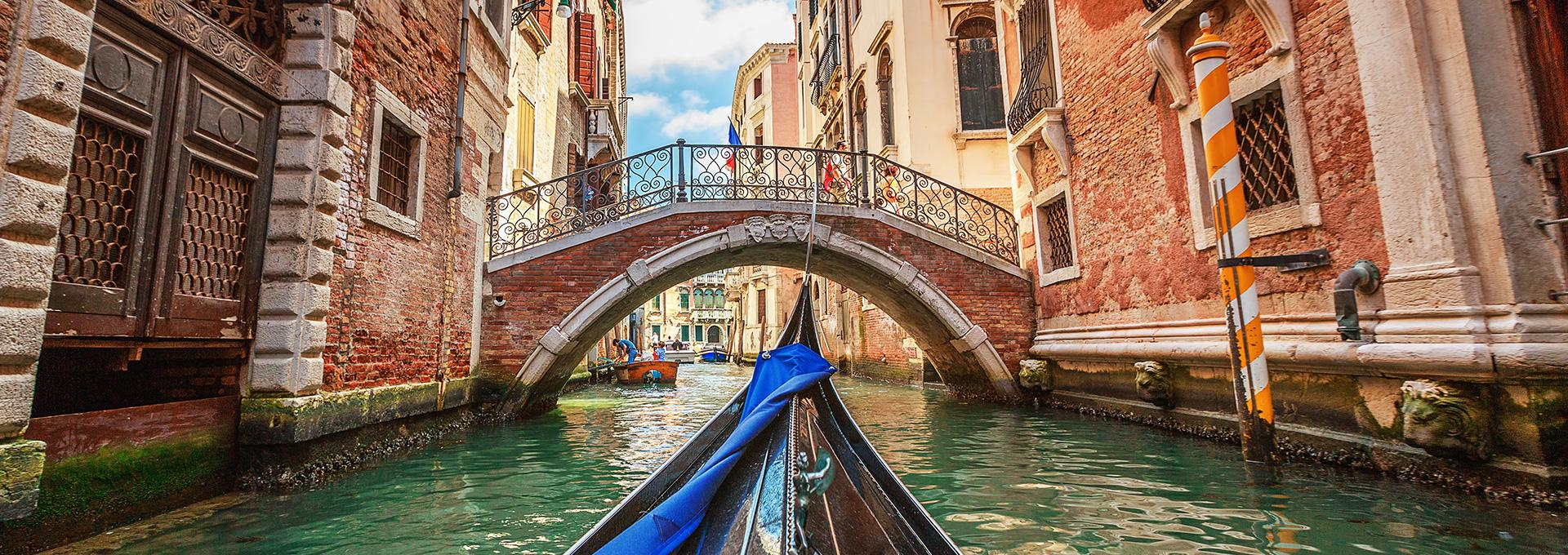 view of a canal from a gondola in Venice, Italy