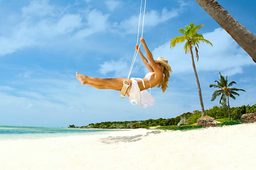 woman on a swing at the beach